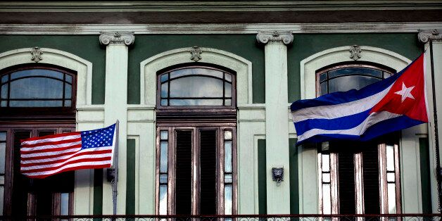 A Cuban and U.S. flag wave from the balcony of the Hotel Saratoga where a U.S. Congressional delegation...
