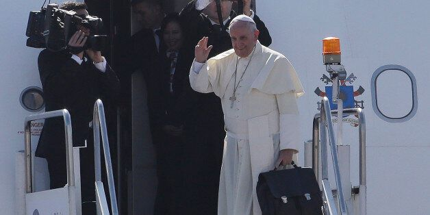 Pope Francis waves before boarding his plane as he departs Manila, Philippines on Monday, Jan. 19, 2015....