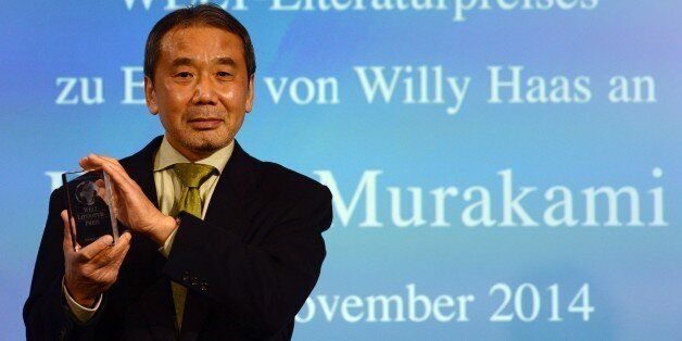 Japanese writer Haruki Murakami poses with his trophy prior to an award ceremony for the Germany's Welt...