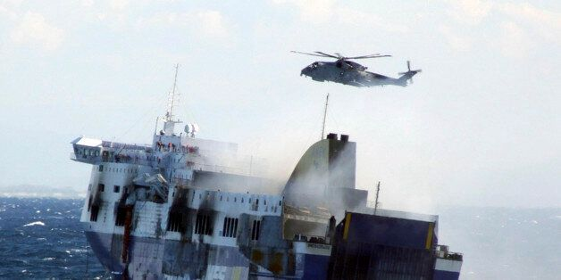 In this image released by the Italian Navy, smoke billows from the Italian-flagged Norman Atlantic that...