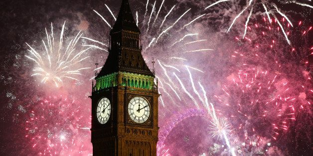 LONDON, ENGLAND - JANUARY 01: Fireworks light up the London skyline and Big Ben just after midnight on...
