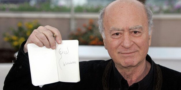 FILE - This Friday, May 16, 2008, file photo shows French cartoonist Georges Wolinski displaying one...