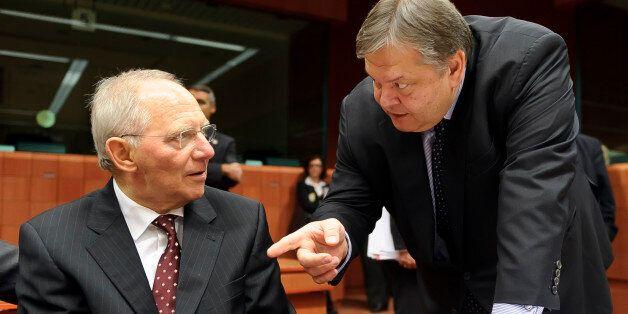 Wolfgang Schaeuble, Germany's finance minister, left, speaks with Evangelos Venizelos, Greece's finance...