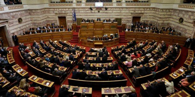 Greek lawmakers attend the third round of voting to elect a new Greek president at the Parliament in...