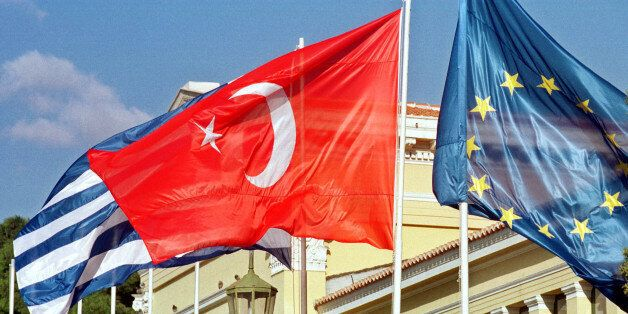 ** FILE ** The Turkish flag, center, flanked by the Greek, left, and European Union flags, flies outside...