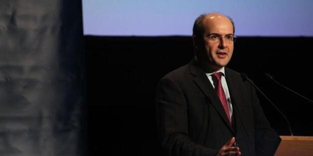 Greek Minister of Development Kostis Chatzidakis leaves the Finance Ministry after an inter ministerial...