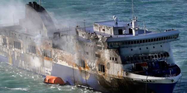 Smoke billows from the Italian-flagged Norman Atlantic ferry that caught fire in the Adriatic Sea, Tuesday,...