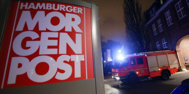 A firef truck sits outside the building of the 'Hamburger Morgenpost' in Hamburg, northern Germany, Sunday...