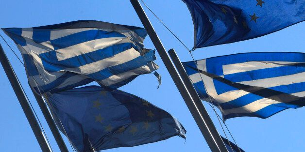 EU and Greek flags fly at the entrance of Thessaloniki's International Exhibition Center, Greece, on...