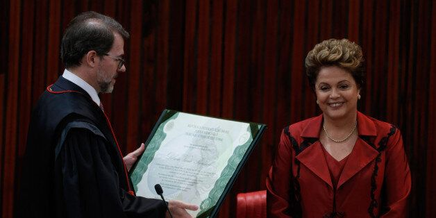 Brazil's President Dilma Rousseff receives a presidential election diploma from the President of the...