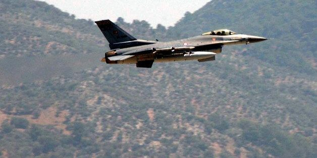 A Turkish Air Force F-16 fighter jet flies over a military airbase in Dalaman near the southwestern Turkish...