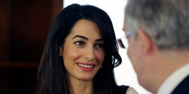 Lawyer Amal Clooney, left, speaks with Greek Culture Minister Kostas Tassoulas, during their meeting...