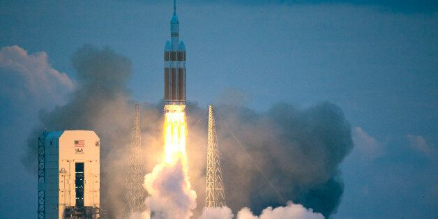 The NASA Orion space capsule atop a Delta IV rocket, in its first unmanned orbital test flight, lifts...