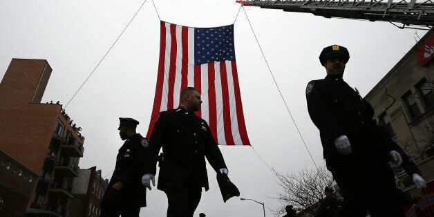 NEW YORK, NY - JANUARY 04: Police officers from around the country attend the funeral of slain New York...