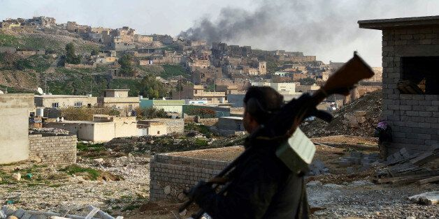 MOSUL, IRAQ - DECEMBER 21: Smoke rises during the clashes between Peshmerga forces and Islamic State...
