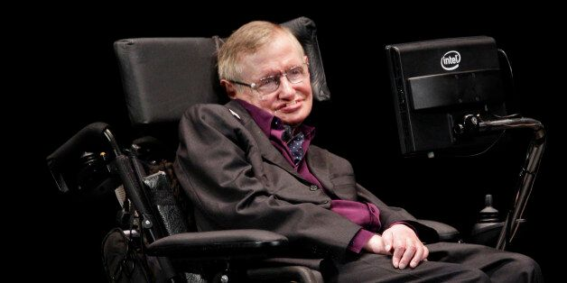 Physicist and best-selling author Stephen Hawking appears, Saturday, June 16, 2012, in Seattle. Hawking was taking part in the Seattle Science Festival Luminaries Series. (AP Photo/Ted S. Warren)