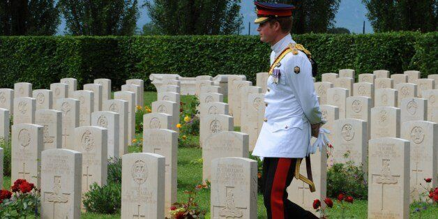Prince Harry of Great Britain visits the British War Cemetery of Cassino on May 19, 2014 as part of the...