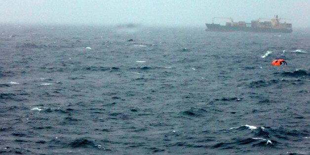 In this photo taken from a nearby boat shows a life raft believed to be from the Italian-flagged Norman...
