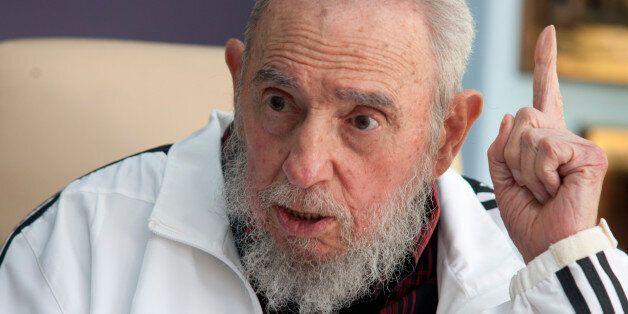 FILE - In this July 11, 2014 file photo, Cuba's Fidel Castro speaks with Russia's President Vladimir...
