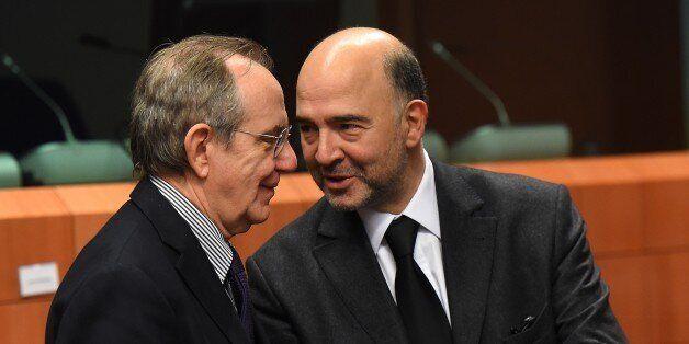 Italian Finance Minister Pier Carlo Padoan (L) and EU economic and financial affairs, taxation and customs...