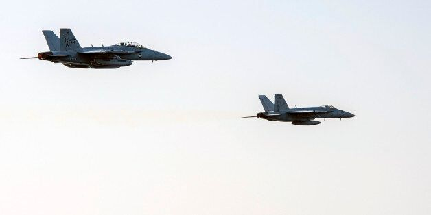 In this image released by the U.S. Navy on Friday, Dec. 5, 2014, an fighter jets conduct a high speed...