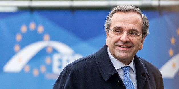 Greece's Prime Minister Antonis Samaras arrives for a meeting of EPP members ahead of an EU summit in...
