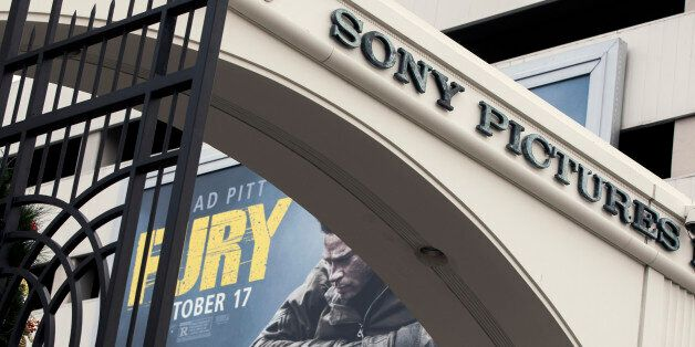 A movie billboard is displayed behind a Sony Pictures Entertainment Studio entrance in Culver City, Calif.,...
