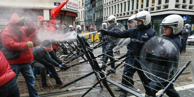 Union members clash with the police outside the N-VA office in Brussels during a national general strike...