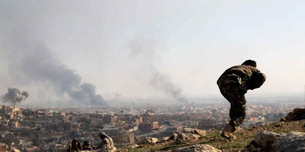 MOSUL, IRAQ - DECEMBER 22: Smoke rises as Islamic State of Iraq and Levant (ISIL) fighters burn tires...