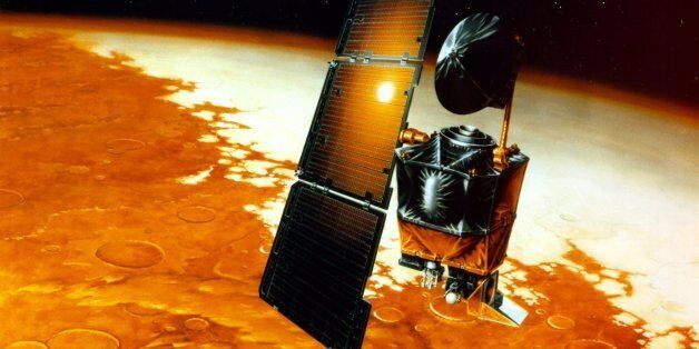 The Mars Climate Orbiter, shown in this illustration, is set to go into orbit around the red planet to...