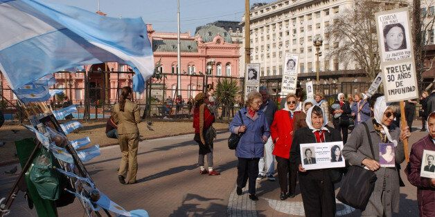 Members of human rights groups Mother of Plaza de Mayo, walk during their weekly protest putside Government...