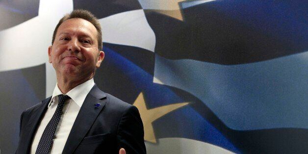 Greece's Finance Minister Yannis Stournaras attends for a news conference with European Union's Vice...