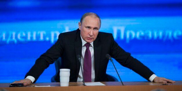 Russian President Vladimir Putin speaks during his annual news conference in Moscow, Russia, Thursday,...