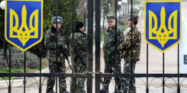 Ukrainian air force pilots guard their air base in Belbek, near Sevastopol, on March 4, 2014. Russian...