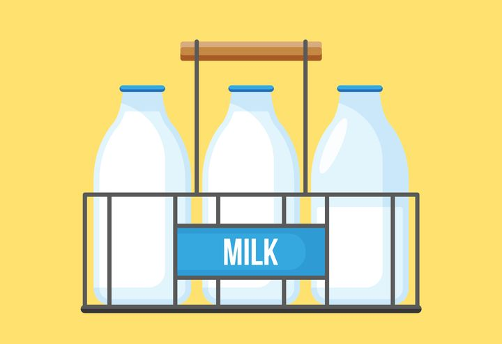 Milk bottles in wire carrier. Retro milk bottles icon for graphic and web design