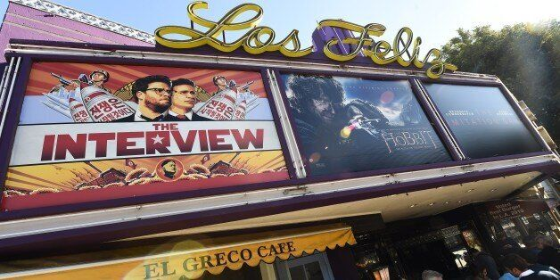 Movie-goers wait in line outside the Los Feliz 3 Cinema in Los Angeles, California December 25, 2014...