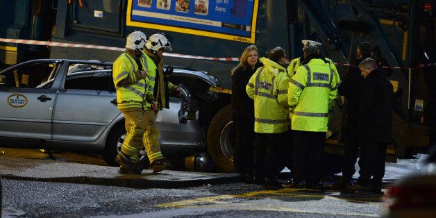 GLASGOW, SCOTLAND - DECEMBER 22: Emergency services attend the scene of the crash in George Square on...