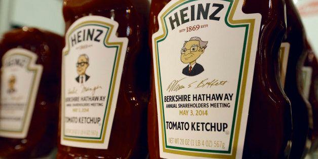 Heinz commemorative Ketchup bottles bear the cartoon likeness of investor Warren Buffett, right, and...