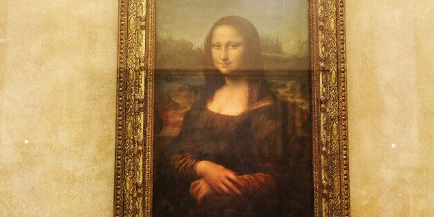 PARIS - AUGUST 24: The famous Leonardo Da Vinci painting ' The Mona Lisa' is seen on display in the Grande...
