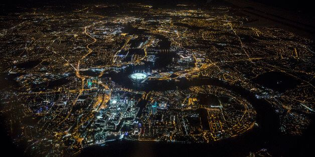LONDON, ENGLAND - MAY 20: An aerial view of the buildings and streets of London, including the O2 Arena...