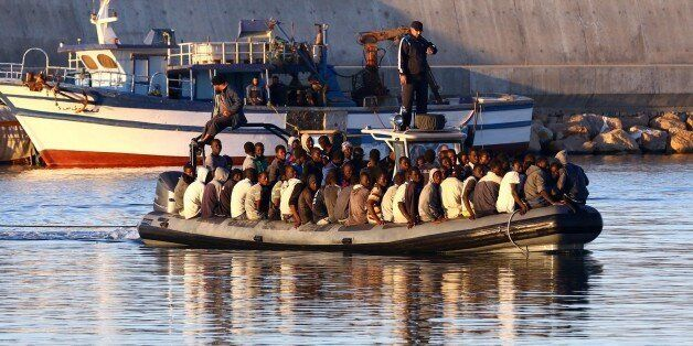 Sub-Saharan African migrants are rescued by the Libyan coastguard after their inflatable boat started...