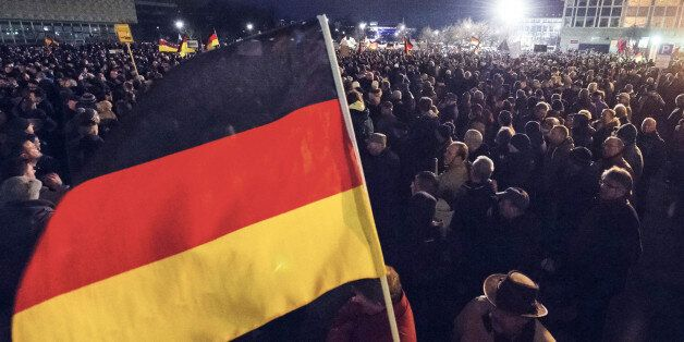 Participants of a rally called 'Patriotic Europeans against the Islamization of the West' (PEGIDA) hold...