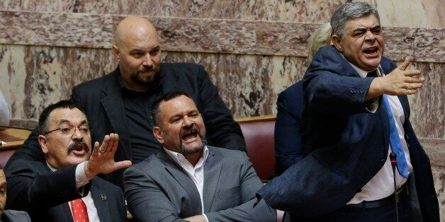 The leader of the far-right political party, Golden Dawn, Nikos Michaloliakos, right, lawmakers Christos...