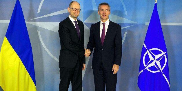 BRUSSELS, BELGIUM - DECEMBER 15: Ukraine's Prime Minister Arseniy Yatsenyuk (L) and North Atlantic Treaty...