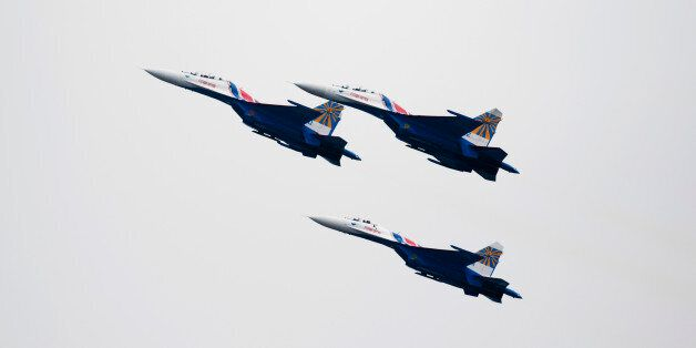 Russian Air Force Knights SU-27 jets, manufactured by Sukhoi Co., fly during an aerobatics display at...