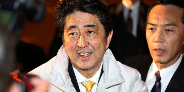 FILE - In this Dec. 13, 2014 photo, Japan's Prime Minister Shinzo Abe smiles during an election campaign...