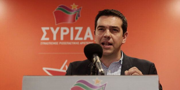 Greek left-wing opposition leader Alexis Tsipras speaks to the press at his party headquarters in central...