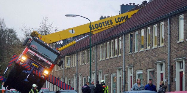 A crane which crashed into the roof of a house is seen following an unusual marriage proposal by a man...