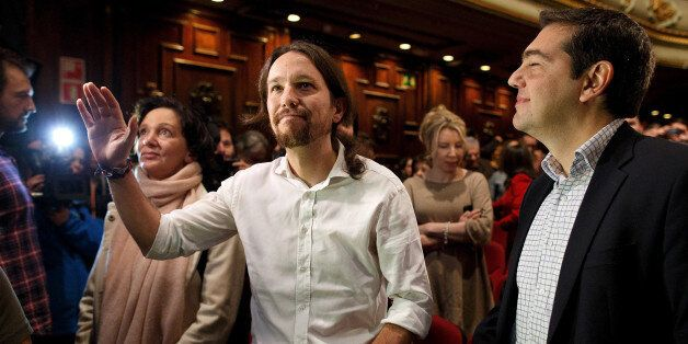 MADRID, SPAIN - NOVEMBER 15: New Podemos Party leader Pablo Iglesias (C) waves next to leader of Greece's...