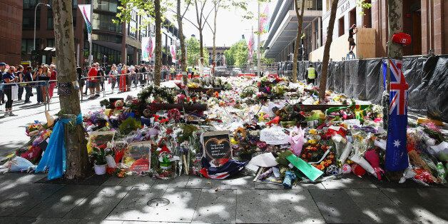 SYDNEY, AUSTRALIA - DECEMBER 23: Flowers can been seen outside the Lindt cafe just prior to being removed...